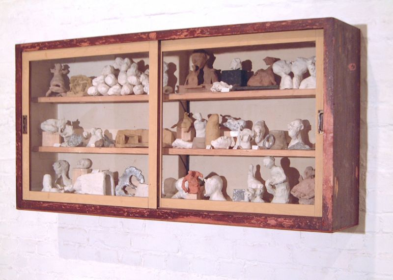 'From the Private Life of the Parasites, Outsiders and Borderes' (detail), glass cabinet, clay, bronze, plumb and legends, Carla Stützer Gallery, Cologne (DE) 2001