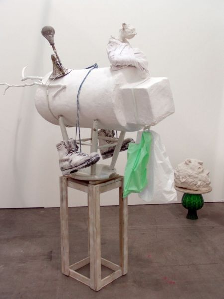from the series 'At Eye Level', cotton long johns, terracotta, plaster, wood, plastic bag, hook, rubber strap, boots, bootlaces, acrylic on branch, stool, horn, 180 x 160 x 80 cm, 2008