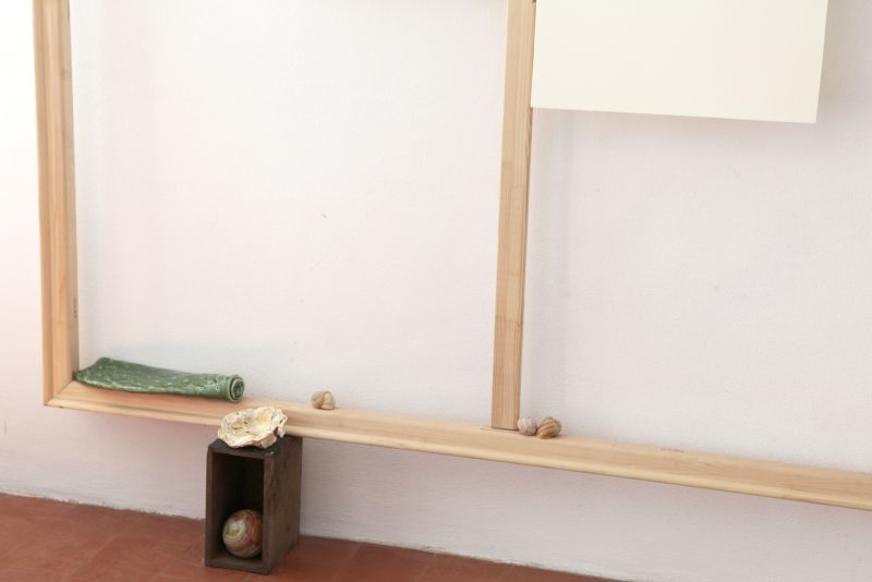 'Still' (detail), stretcher frame, paper, ceramic, snail shells, fossils, stones and wooden drawers with iron handles, 2012