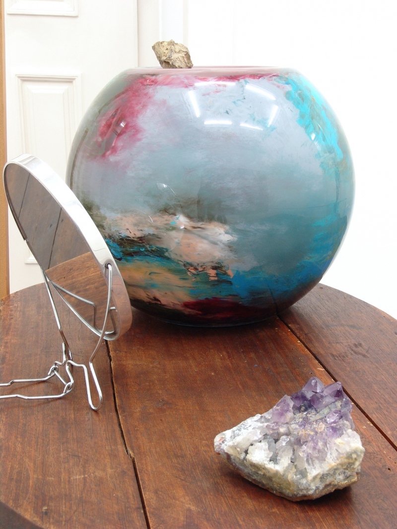 'Further down, leaning against the table, one A1' (detail), wooden table, oil under glass, fossil, mirror, amethyst, 2015