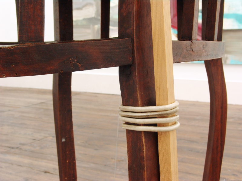 'Further down, leaning against the table, one A1', wooden table, wooden slat and elastic strap, 2015