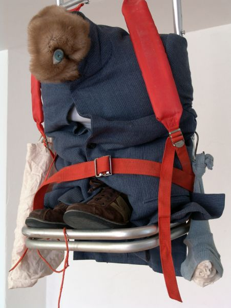 'From the Intertraveller's State', backpackframe, strings, shoes, clothes, fake fur, bags, cuttings, fired clay, hooks, 150 x 45 x 40 cm, 2006